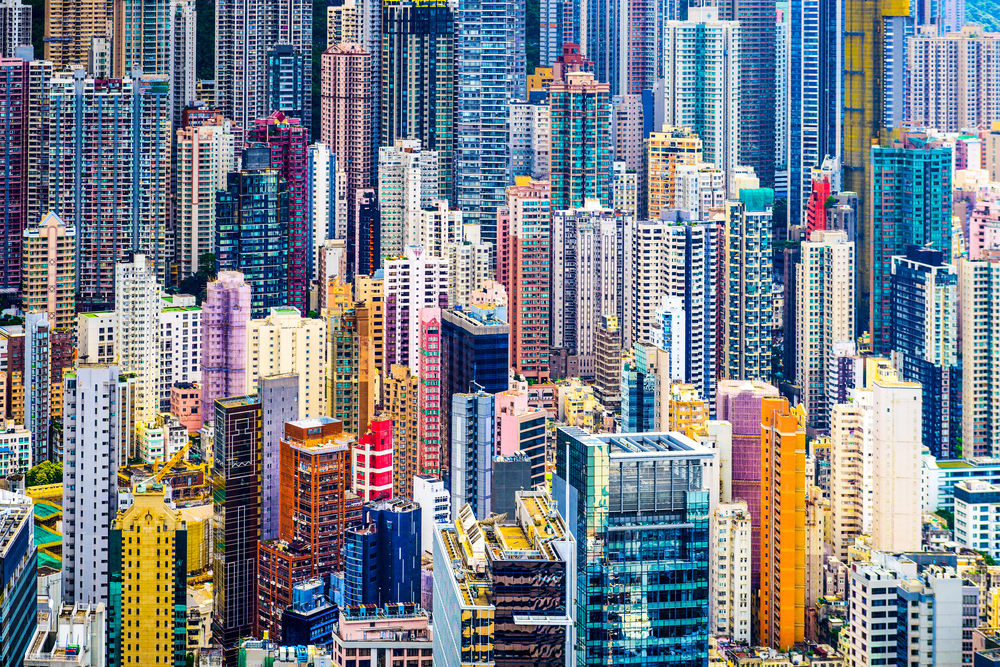 Hong Kong, China dense cityscape of office buildings.