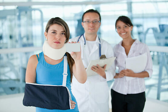 Injured insured woman displaying an insurance card