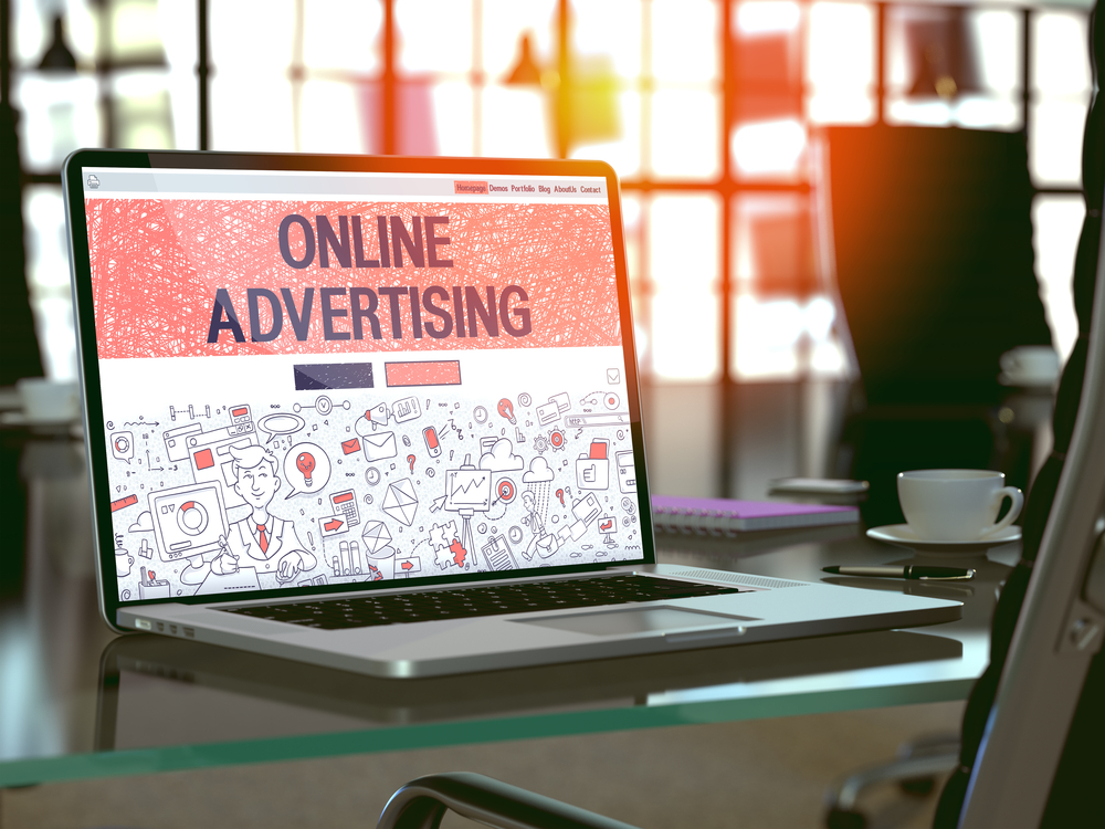 Online Advertising Concept. Closeup Landing Page on Laptop Screen in Doodle Design Style. On Background of Comfortable Working Place in Modern Office. Blurred, Toned Image. 3D Render.-1